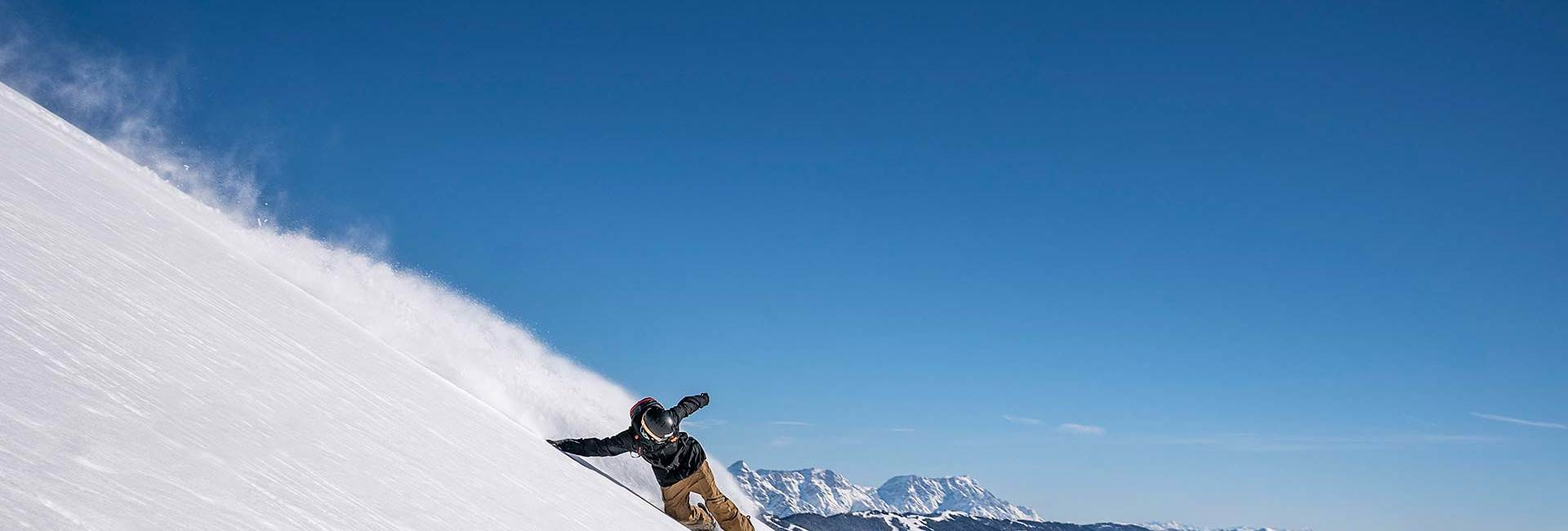 Snowboarder in the powder snow