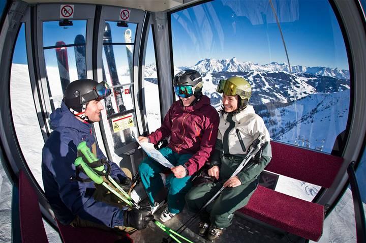 skiers in a gondola